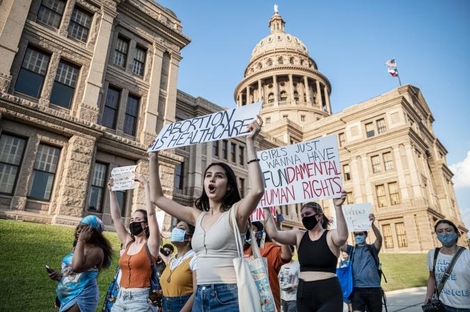 AUSTIN, TX - SEPT 1: Pro-choice protesters march outside the Texas State Capitol on Wednesday, Sept. 1, 2021 in Austin, TX. Texas passed SB8 which effectively bans nearly all abortions and it went into effect Sept. 1. A request to the Supreme Court to block the bill went unanswered and the Court still has yet to take any action on it. (Sergio Flores For The Washington Post via Getty Images)