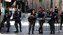 Two Israeli police officers killed by Palestinian gunmen near Jerusalem holy site, police say