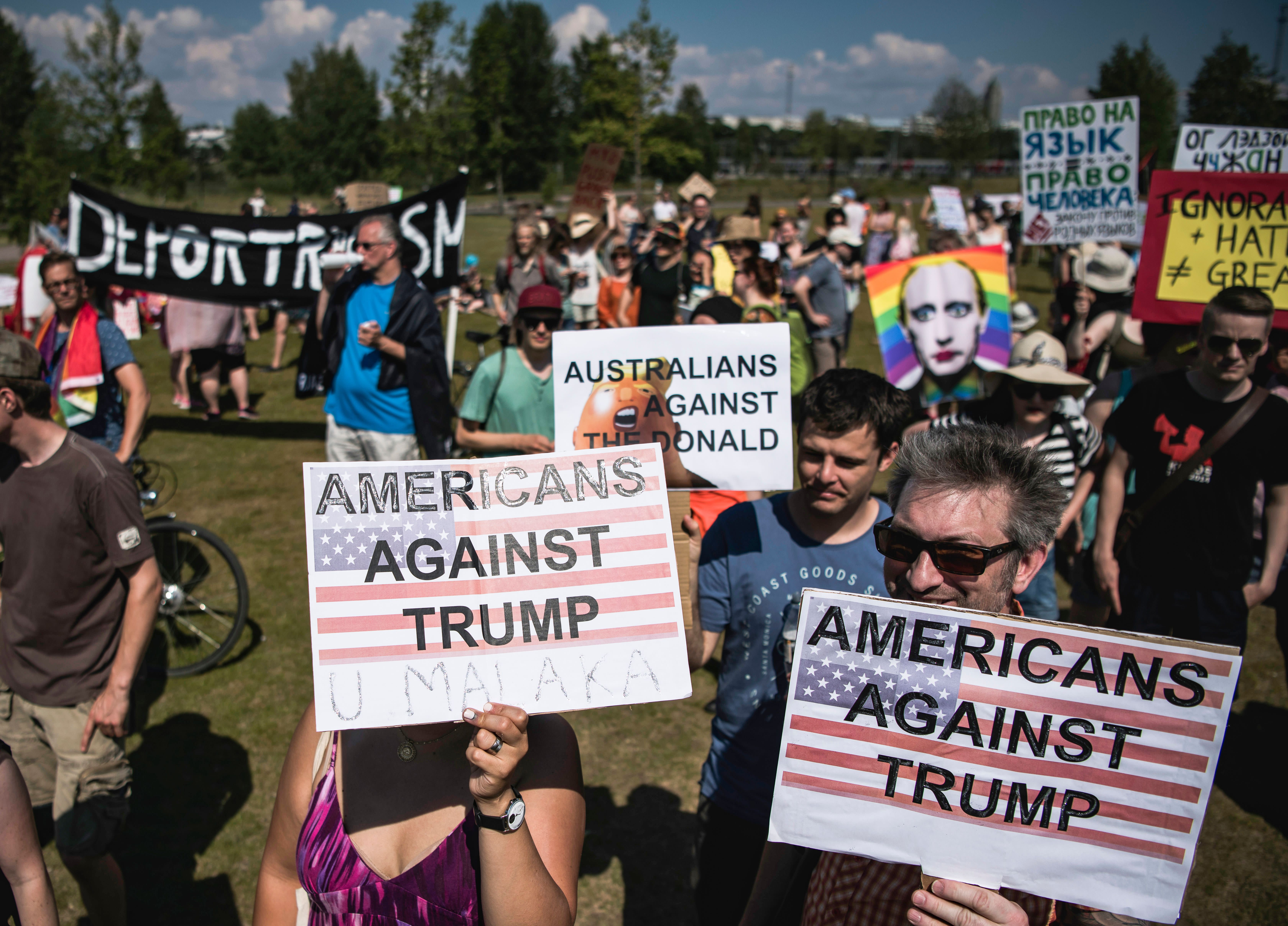 """<p>Protesters take part in the so-called """"Helsinki against Trump and Putin"""" demonstration on the sidelines of the meeting between US President Donald Trump and Russian counterpart Vladimir Putin on July 16, 2018, in Helsinki, Finland. (Photo: Jonathan Nackstrand/AFP/Getty Images) </p>"""
