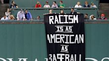 Anti-racism protesters removed after hanging banner at Fenway Park