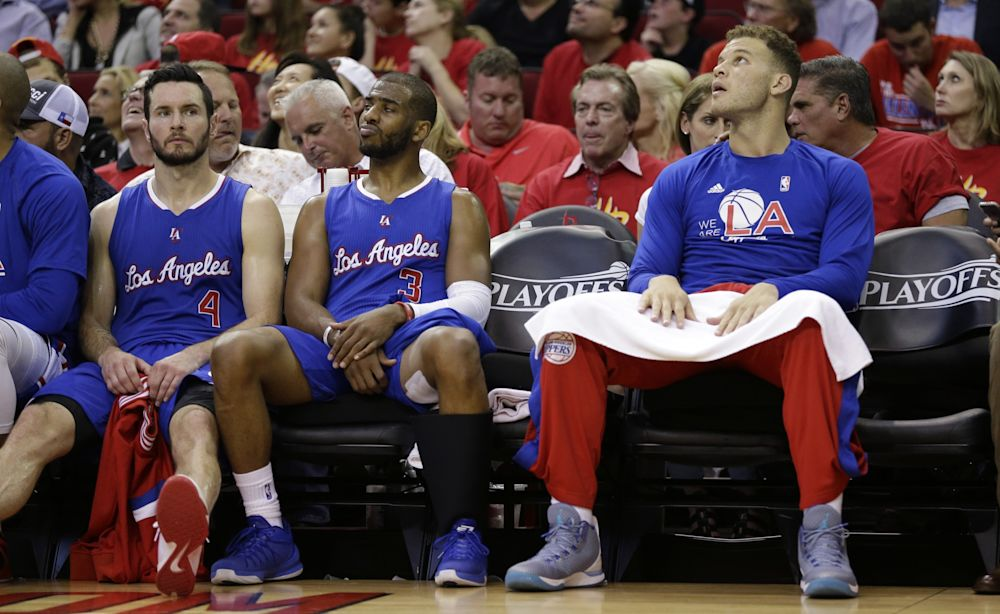 The Clippers can't afford to keep J.J. Redick, Chris Paul and Blake Griffin. (AP)