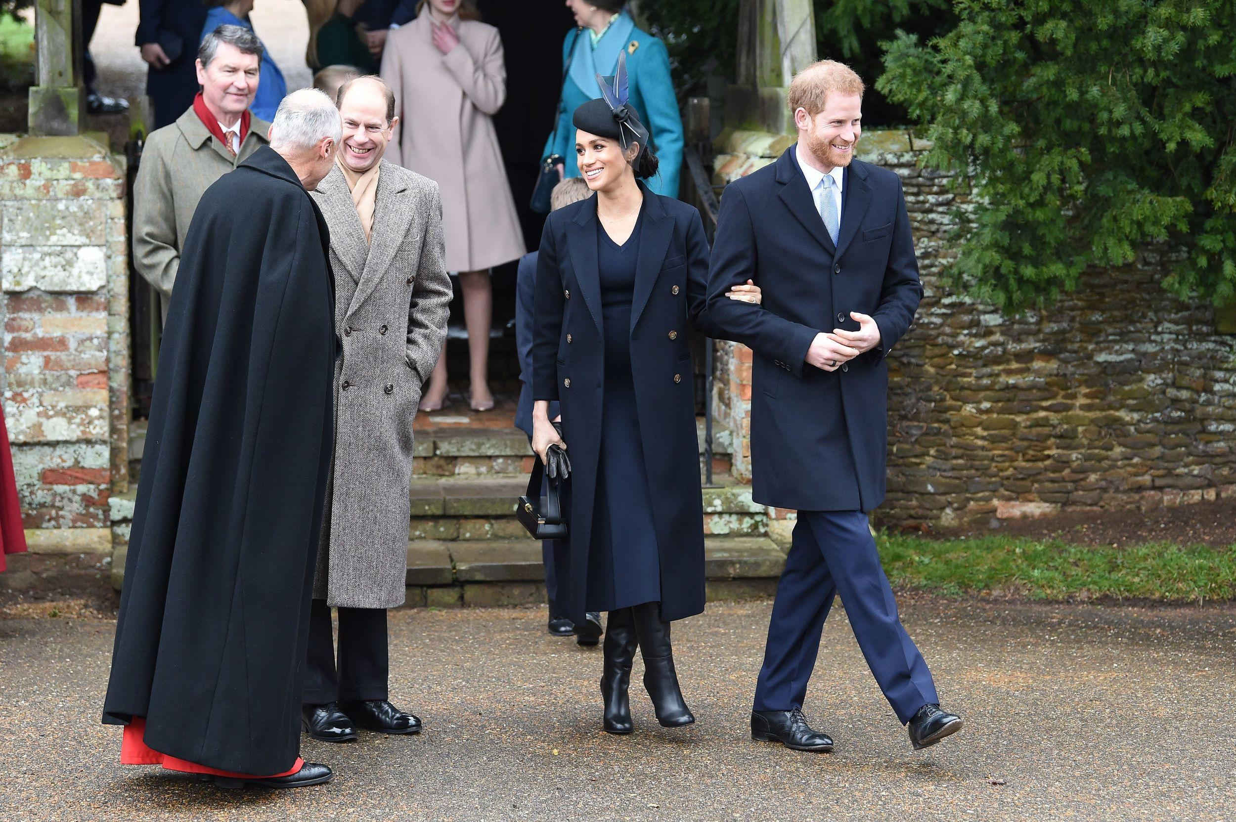 Britain's Prince Edward, Earl of Wessex (L), Meghan, Duchess of Sussex and Britain's Prince Harry, Duke of Sussex depart after the Royal Family's traditional Christmas Day service at St Mary Magdalene Church in Sandringham, Norfolk, eastern England, on December 25, 2018. (Photo by Paul ELLIS / AFP)        (Photo credit should read PAUL ELLIS/AFP/Getty Images)