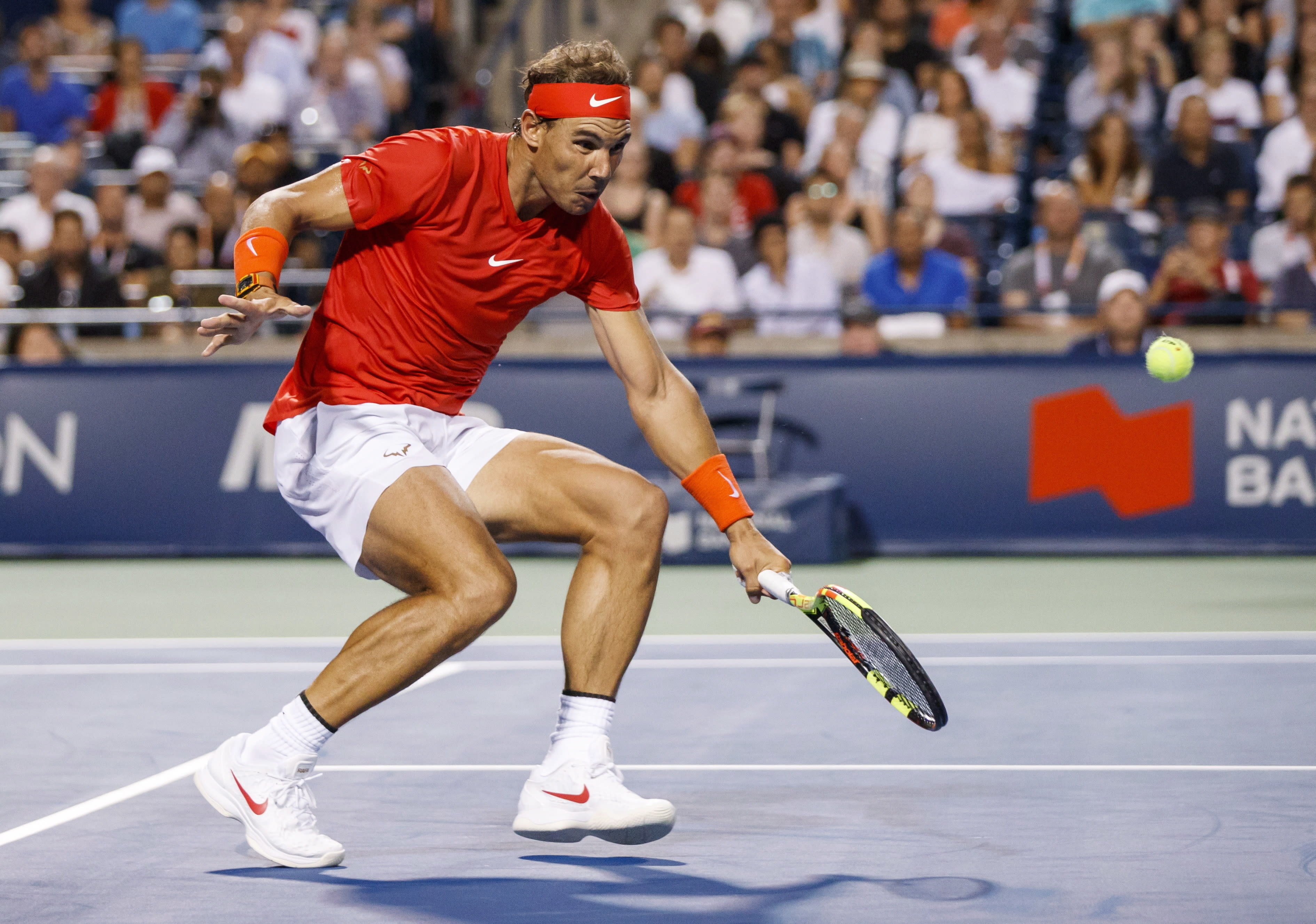 Rafael Nadal, of Spain, returns a shot to Benoit Paire, of France, during the Rogers Cup men's tennis tournament in Toronto, Wednesday, Aug. 8, 2018. (Mark Blinch/The Canadian Press via AP