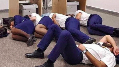 The truth behind photo of airline staff 'sleeping on floor'
