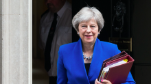 Theresa May promises 'smooth and orderly Brexit' after defeating pro-EU rebellion