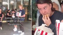 TikTok duo eat KFC in front of vegan protesters in Melbourne