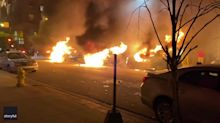Row of Police Cars Engulfed in Flames During Protests in Grand Rapids