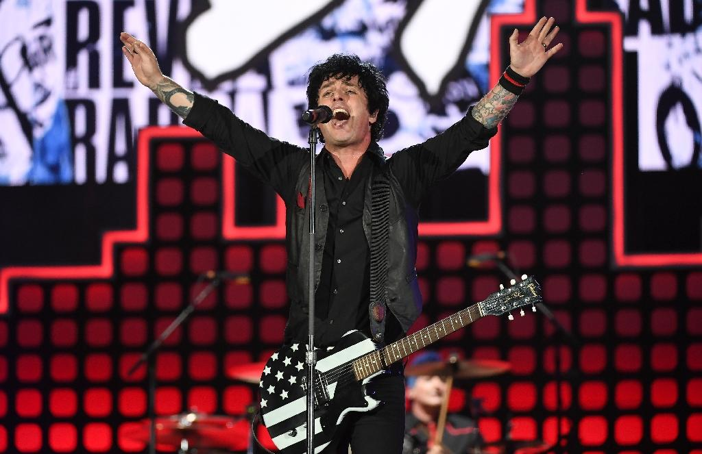 """Punk rock greats Green Day injected politics as well, with frontman Billie Joe Armstrong weaving Trump into the lyrics of """"American Idiot,"""" the band's high-octane 2004 indictment of US media culture (AFP Photo/ANGELA WEISS)"""