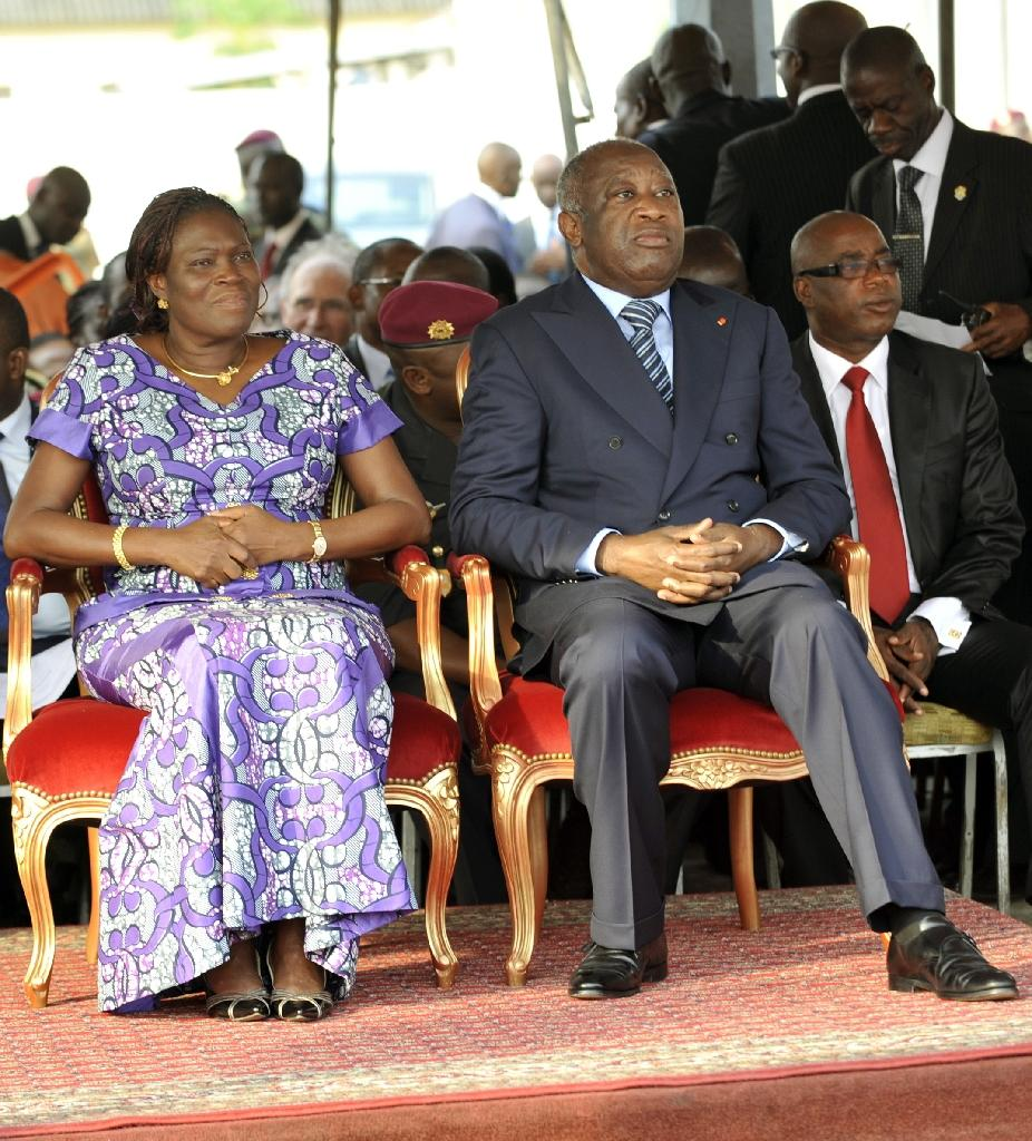 Ivory Coast's then-strongman Laurent Gbagbo (R) and his wife Simone attend a ceremony in Abidjan to pay tribute to thirty-two members of the National Armed Forces of Ivory Coast who lost their lives during post-electoral violence, February 4, 2011 (AFP Photo/Sia Kambou)