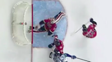 Calgary goalie makes behind-the-back glove save for the first great highlight of the NHL year
