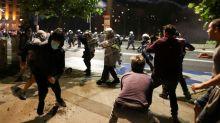 Dozens injured in Belgrade rioting sparked by new virus lockdown