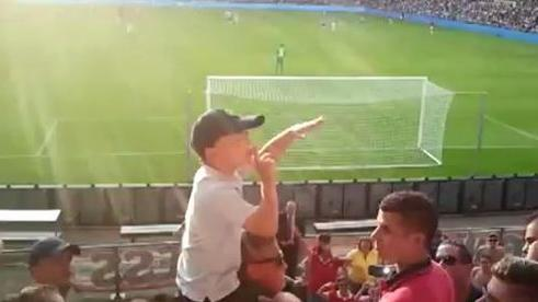 Young boy leads PSV Eindhoven soccer chants