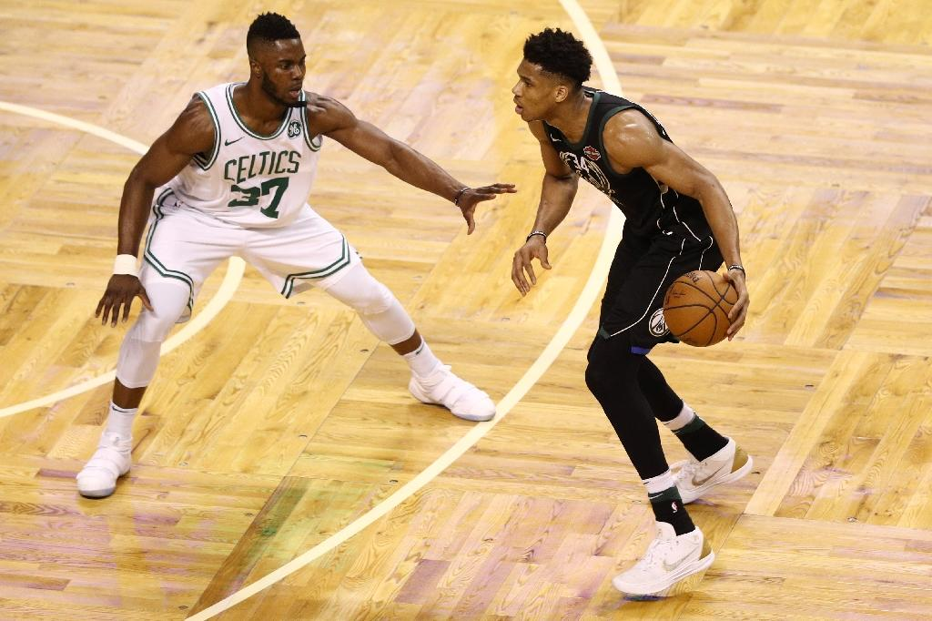 Semi Ojeleye of the Boston Celtics defends Giannis Antetokounmpo of the Milwaukee Bucks as Boston took a 3-2 series lead with a 92-87 win