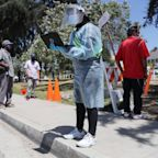 U.S. reports a record 60,000 new coronavirus cases in one day