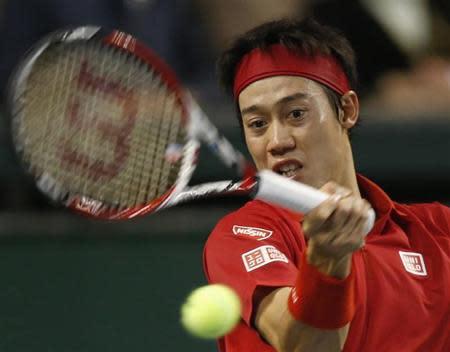 Japan's Nishikori returns shot against Canada's Dancevic during Davis Cup world group first round tennis match in Tokyo