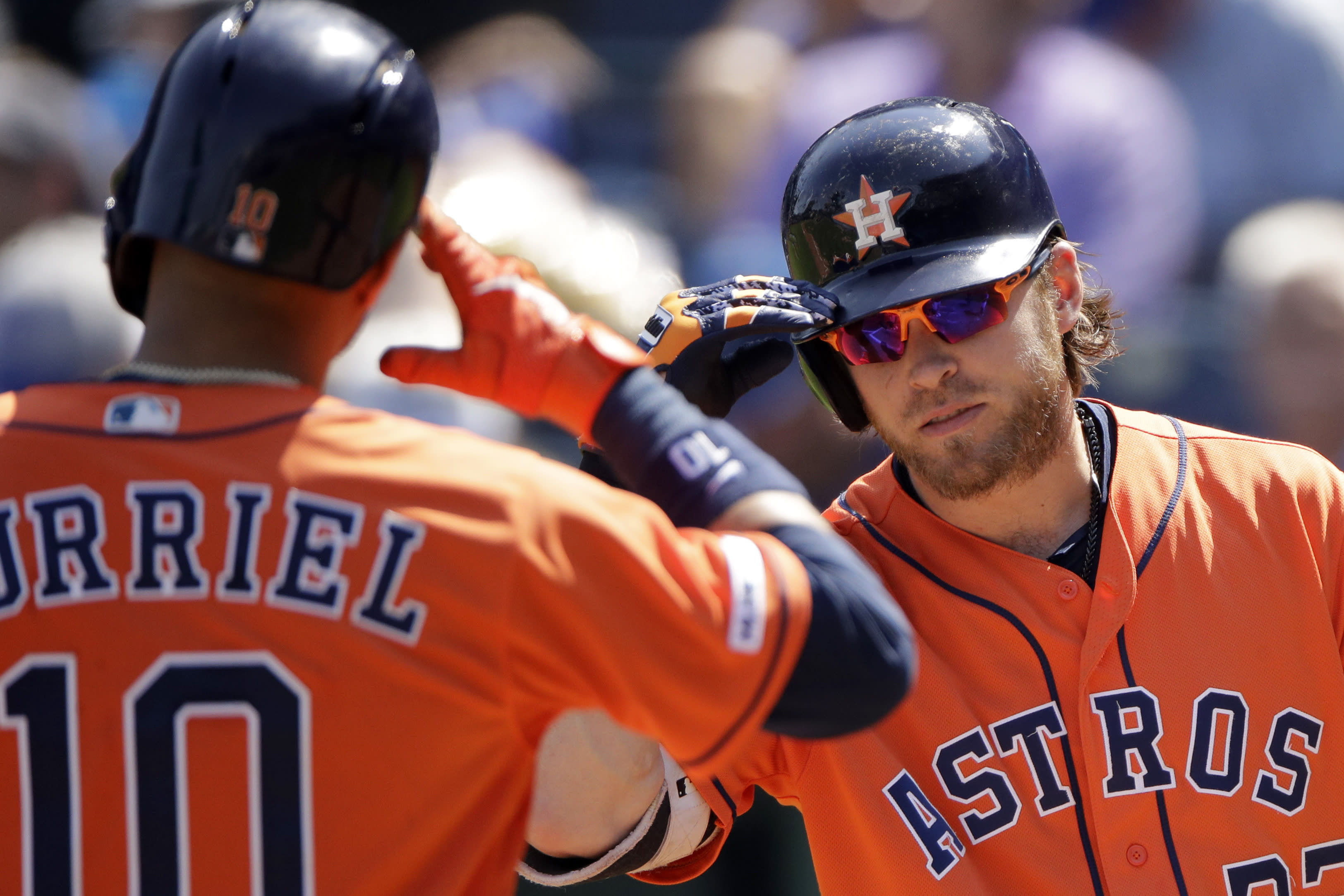 Houston Astros' Yuli Gurriel (10) celebrates with Josh Reddick after hitting a solo home run during the second inning of a baseball game against the Kansas City Royals Sunday, Sept. 15, 2019, in Kansas City, Mo. (AP Photo/Charlie Riedel)