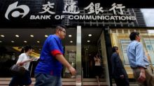 Chinese banks battle slowing loan growth, default risks loom