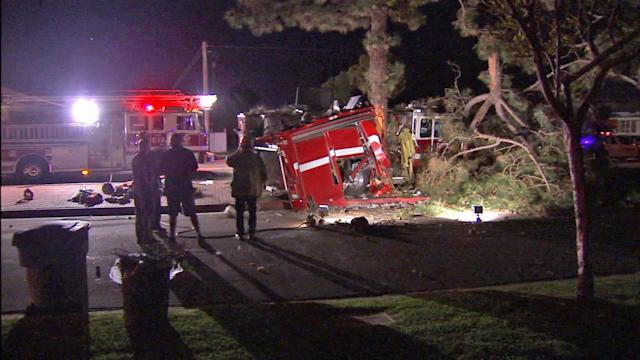 Fire truck hits tree, splits in half; 4 firefighters hurt