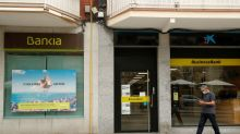 Caixabank strikes $5 billion Bankia deal as more European bank mergers loom