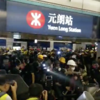 Makeshift Barricade Erected at Hong Kong's Yuen Long Station as Protesters Face Police