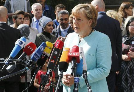 German Chancellor Merkel gives a statement after her visit to a refugee camp near the Federal Office for Migration and Refugees at Berlin's Spandau district