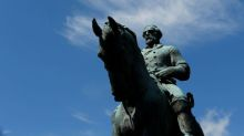 Charlottesville to cover Confederate statues after chaotic meeting