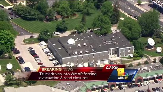 Photojournalist reports about vehicle into WMAR building