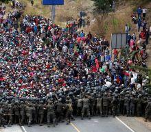 Guatemalan forces clash with migrant caravan, Biden team seeks to halt exodus