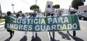 "Family members of Andres Guardado hold a sign which reads ""Justice for Andres Guardado"" in Spanish. (AP)"