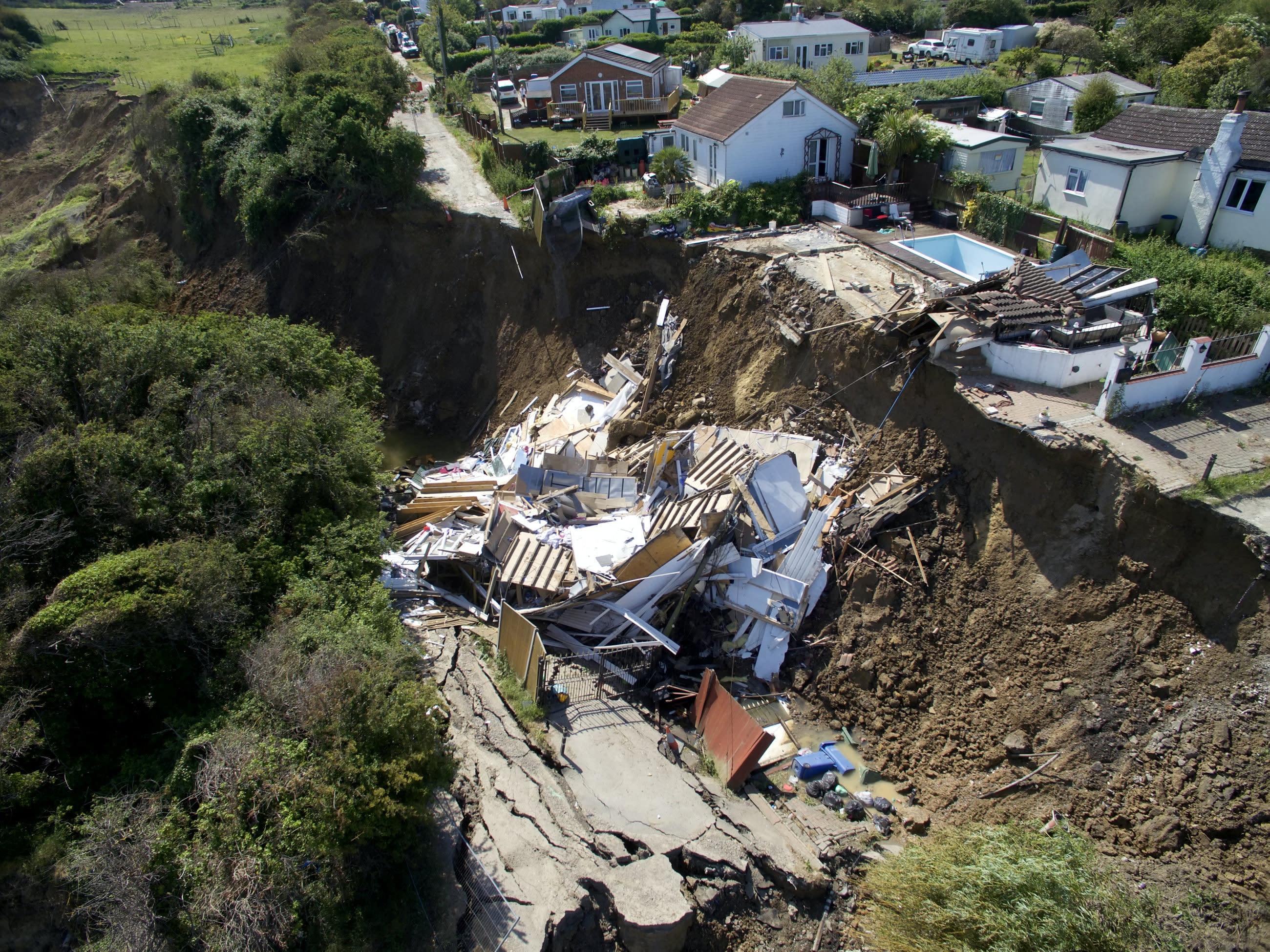 Mother's £200,000 dream home left hanging over Kent cliff falls off after another landslide