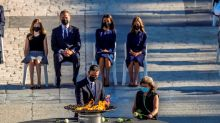 Black masks, white roses as Spain honours its COVID-19 victims