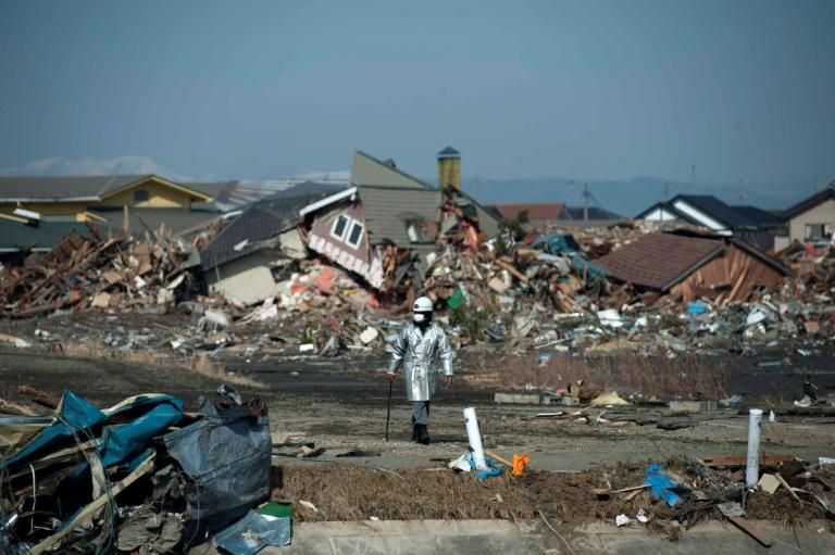 Japan's March 2011 tsunami swept away residents, destroyed homes and gutted concrete buildings (AFP Photo/STR)