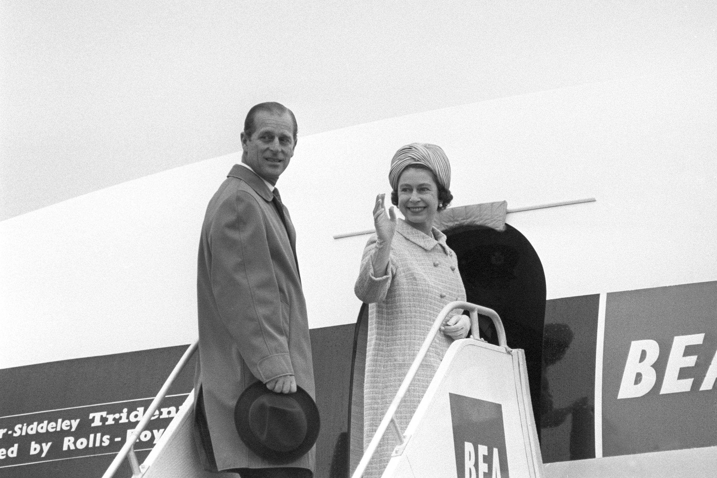 Queen Elizabeth II and the Duke of Edinburgh board their Trident airliner of the British European Airways at Heathrow Airport, on their way to Malta for a four-day visit.