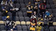 Penguins admit they photoshopped masks on fans