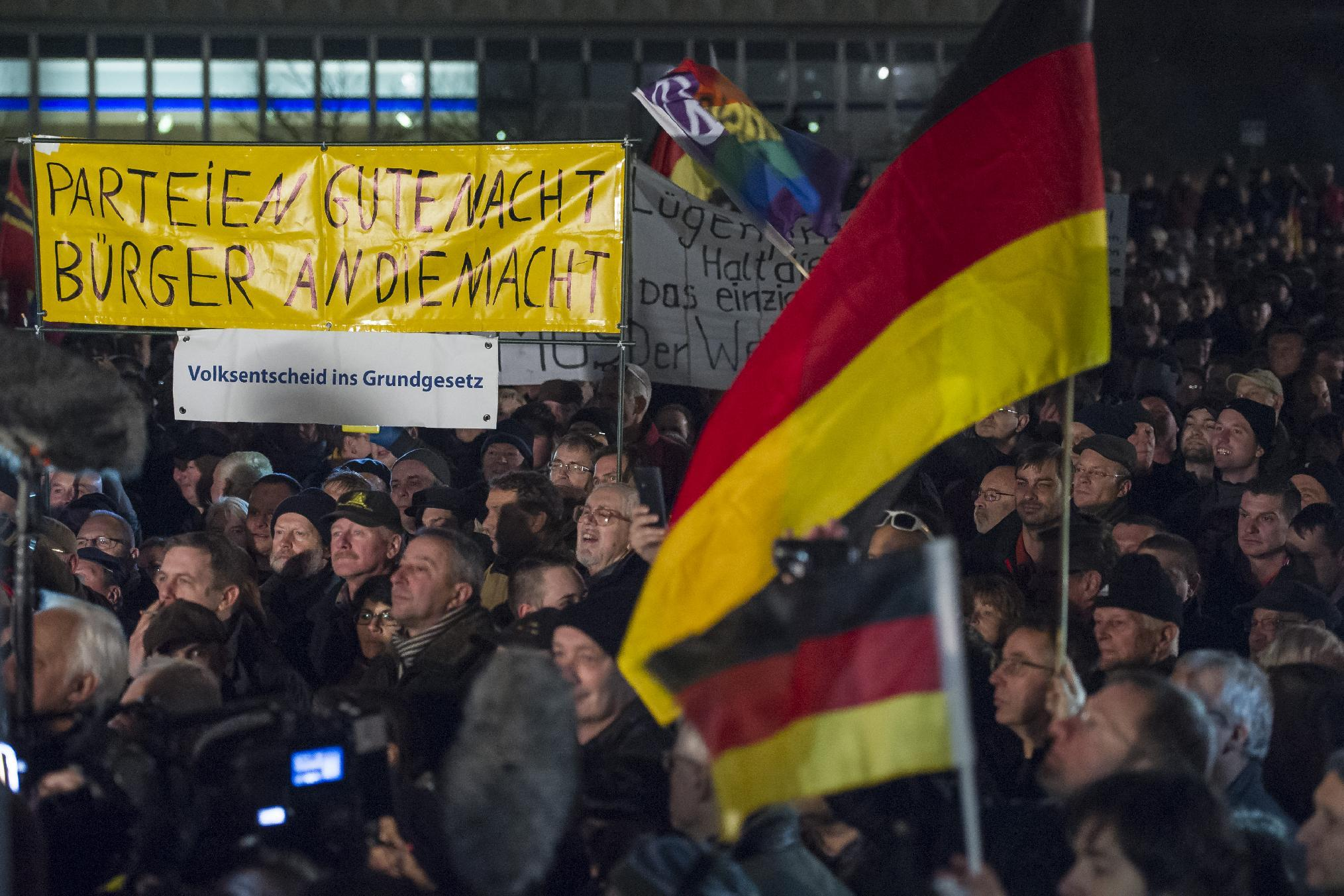 """Supporters of the """"Patriotische Europaeer Gegen die Islamisierung des Abendlandes"""" movement, which translates to """"Patriotic Europeans Against the Islamification of the Occident,"""" take part in a rally in Dresden, Germany on December 15, 2014 (AFP Photo/Jens Schlueter)"""