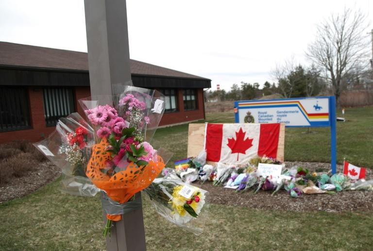 An impromptu memorial (pictured April 2020) sits in front of the home detachment of slain RCMP Constable Heidi Stevenson, who was one of the people killed during Canada's worst-ever mass shootings