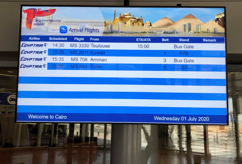 An arrivals board is pictured at the Cairo's International Airport after its reopening, following the outbreak of the coronavirus disease (COVID-19), in Cairo