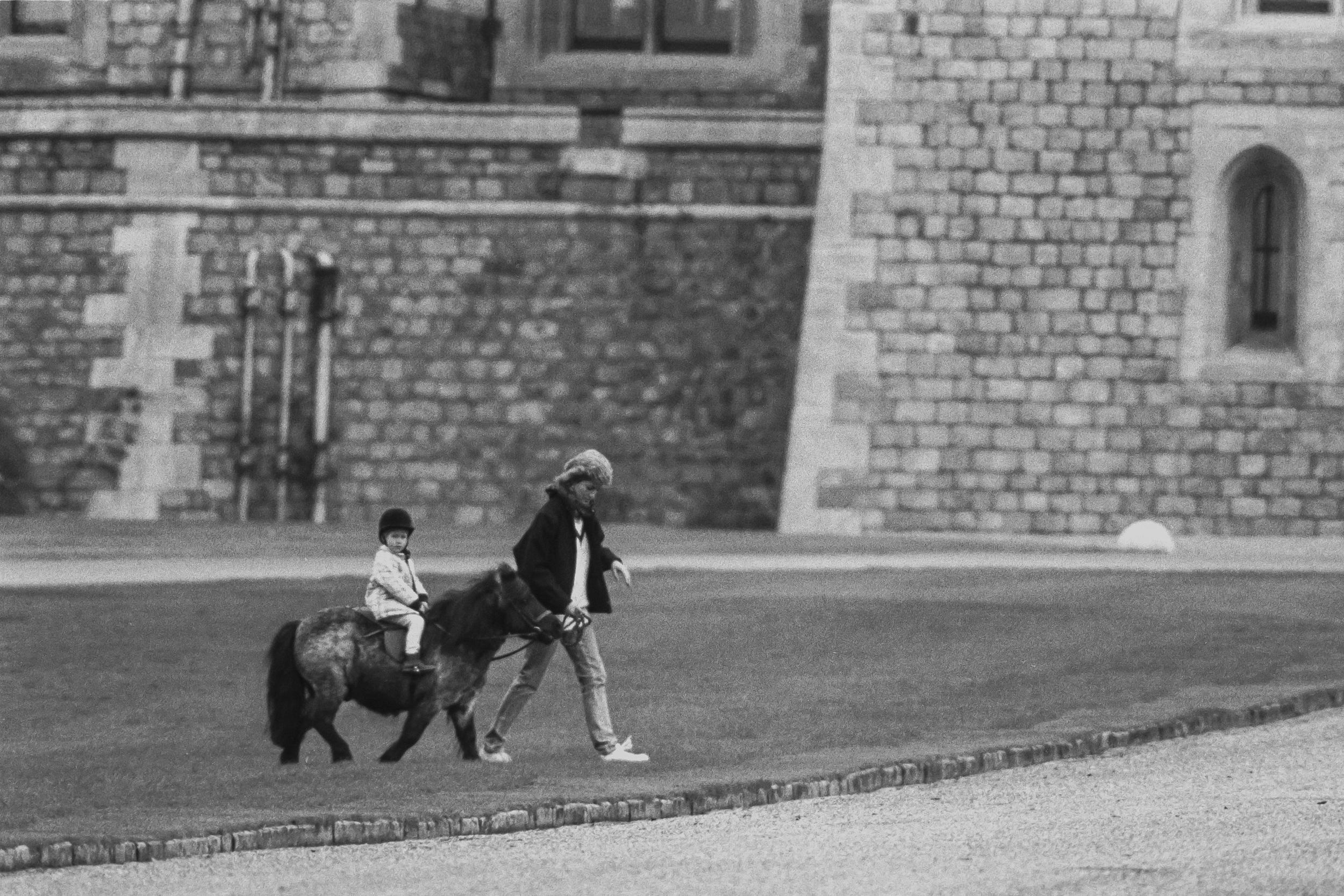 WINDSOR,  UNITED KINGDOM  - APRIL 2:   Diana, Princess of Wales, with  Prince Harry, during the Easter Weekend, at Windsor Castle, on April 2,  1988 in Windsor, United Kingdom. (Photo by Julian Parker/UK Press via Getty Images)