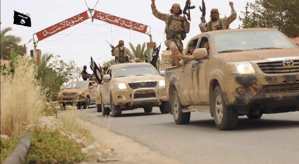 An image grab taken from a video made available by Jihadist media outlet Welayat Homs on July 4, 2015 shows Islamic State (IS) jihadist group fighters in Tadmur, Syria