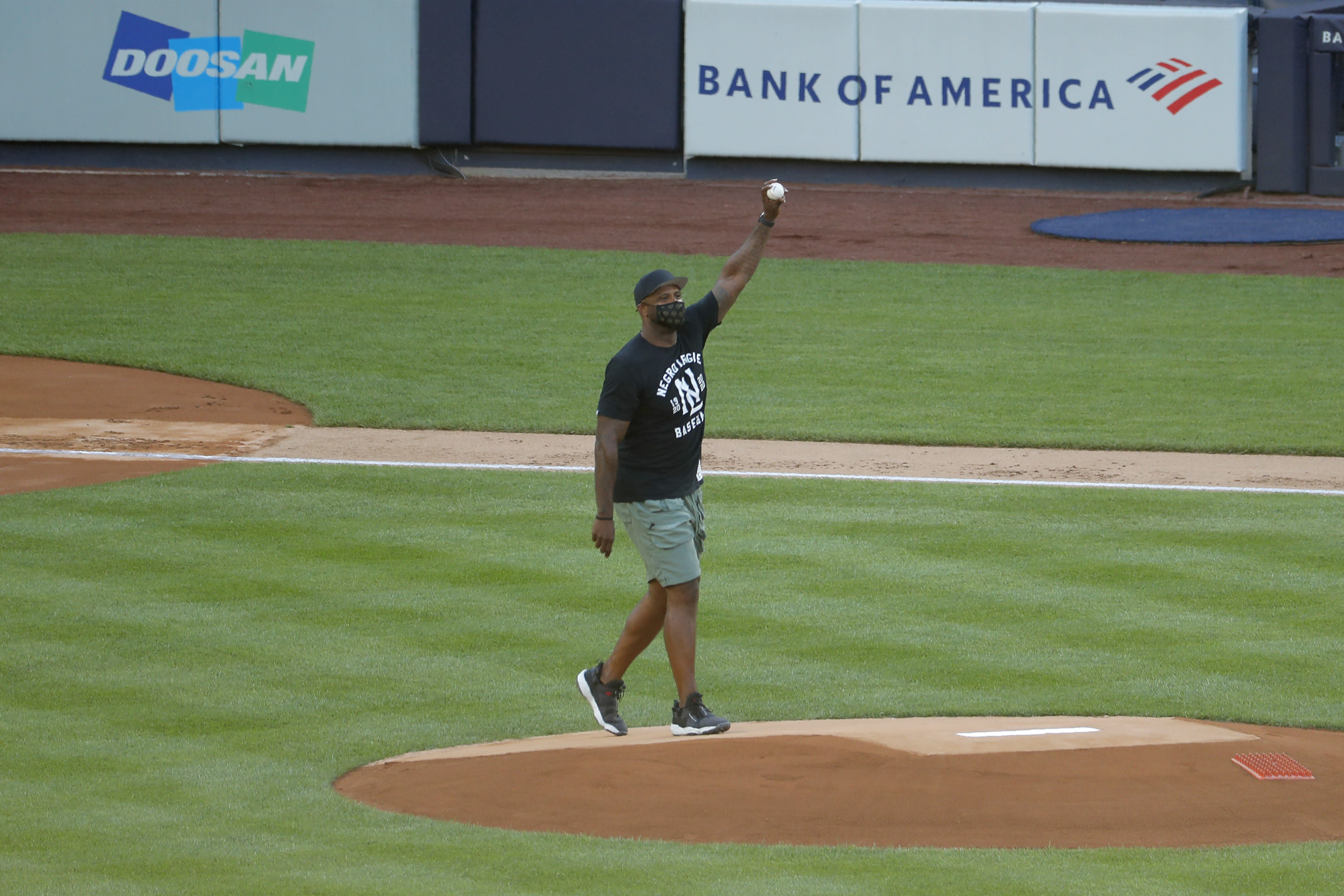 Former New York Yankees pitcher C.C. Sabathia gestures before throwing out the first pitch before the baseball game against the Boston Red Sox at Yankee Stadium, Friday, July 31, 2020, in New York. (AP Photo/Seth Wenig)