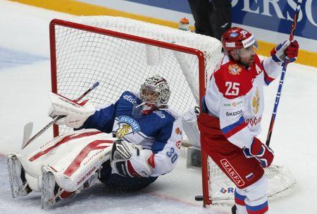 Finland's goaltender Sateri reacts after failing to save goal by Russia's Zaripov during their Channel One Cup ice hockey game in Moscow