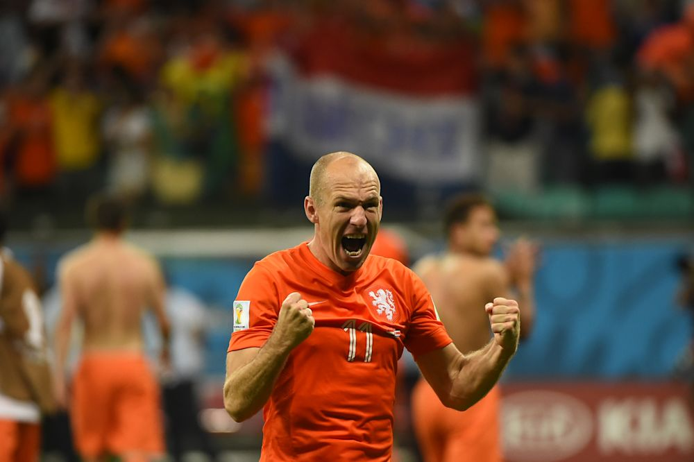 Netherlands' forward Arjen Robben celebrates after defeating Costa Rica during the penalty shootout after the extra time in the quarter-final football match at the Fonte Nova Arena in Salvador on July 5, 2014