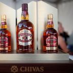 Pernod Ricard's new profit forecast lifts shares to record high