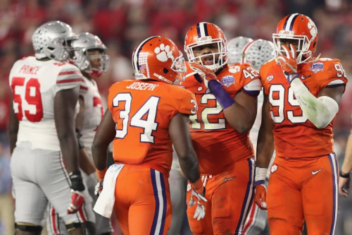 Clemson defensive lineman Christian Wilkins celebrates with linebacker Kendall Joseph (34) and defensive end Clelin Ferrell (99) at the Fiesta Bowl. (Getty)