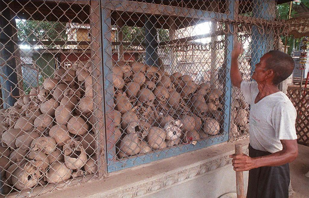 Skulls and bone fragments of victims of the 1975-79 Khmer Rouge regime at the Champuk Kaek pagoda in Kandal province, south of Phnom Penh in 1997 (AFP Photo/David van der Veen)