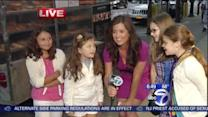 Amy sings Selena Gomez with young fans