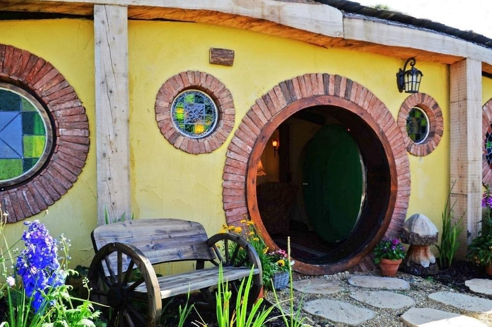 """<p>Children large and small, and anybody with a playful soul, will be thrilled with this delightful grass-roofed Hobbit house, which invites you to float straight into a magical story book adventure through the picket-fenced cottage garden which blooms with lupins, foxgloves, herbs and wild daisies in spring and summer. At <a href=""""https://www.canopyandstars.co.uk/britain/england/yorkshire/north-shire/the-shire-house"""" target=""""_blank"""">The Shire House</a>, which sleeps six, you'll find a plush, Regency-inspired interior with terracotta floors, wooden beams and a flame-effect log fire. The enchanting bedrooms have cosy cabin beds and the swish bathroom features a golden deep tub and a jam pan sink. From £81 per night.</p>"""