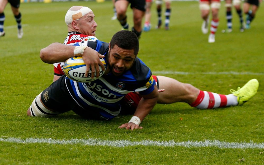 Taulupe Faletau scores the first of his three tries at the Recreation Ground - PA