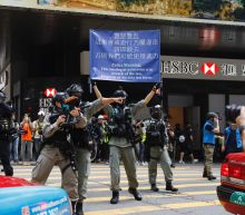 Protesters mass in Hong Kong before anthem law is debated
