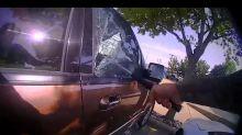 VIDEO - Un policier brise la vitre d'une voiture surchauffée pour en sortir un bébé en pleurs